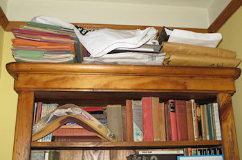 On top of my big bookcase, folders and bags contain the research notes and rough printouts of all my books and short stories - just in case I ever need them again.