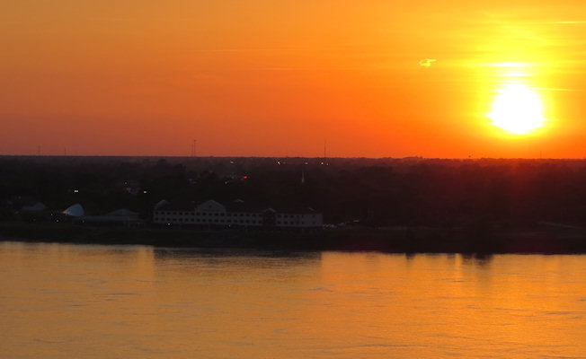 The sun sets over the river at Natchez - where the paddle steamers used to dock.