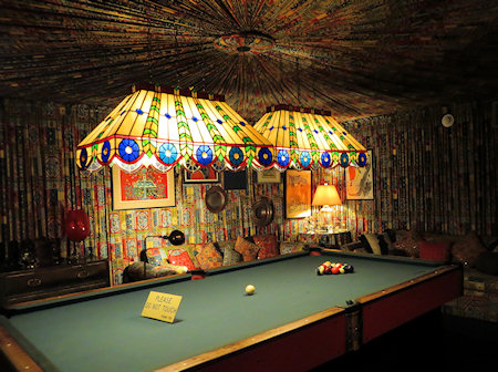 The walls AND ceiling of the billiard room were covered with fan-folded fabric.
