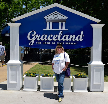 I didn't want a photo in front of the fake Graceland gates - so instead, here I am at the tourist entrance.