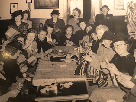 An old photo on display at the museum - knitters still gather like this today to chat - although these days there is often wine involved.