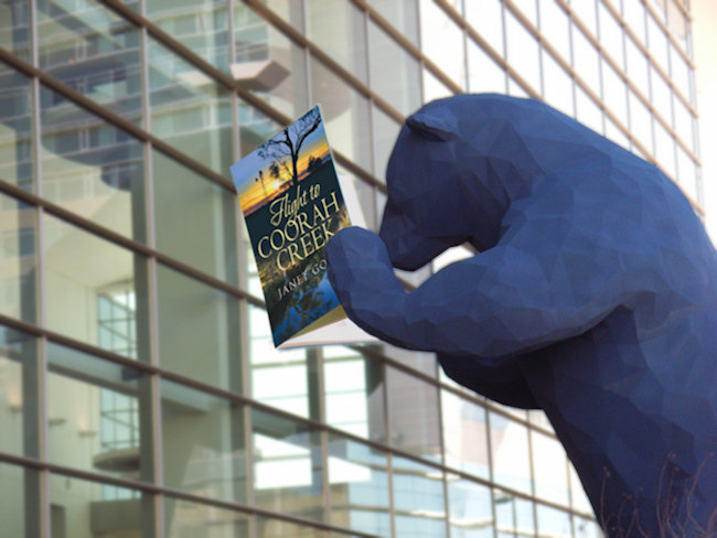 The big blue bear reads romance - courtesy of Webmaster Johns photo manipulation skills.