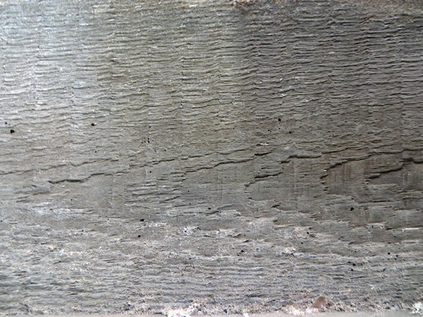 The concrete was poured on site into timber frames - leaving the wonderful patterns of the wood grain embedded in the concrete.