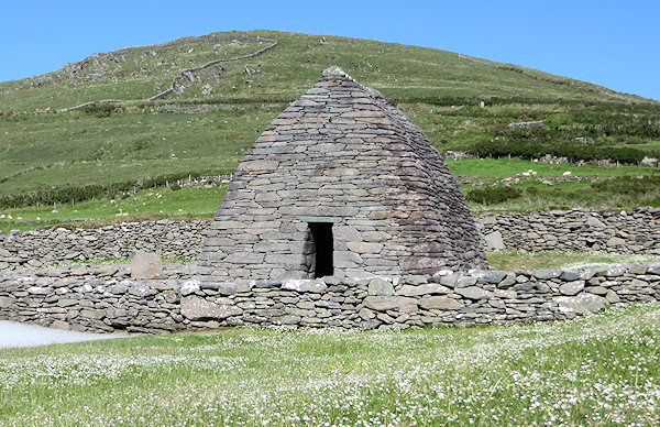 The Gallarus Oratory on the mainland is an example of the type of stone buildings in the monastery. All built without mortar - the walls and roof are held in place by physics alone.