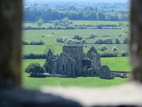Looking through the window of a ruined castle toward a nearby church - also in ruins. My imagination was running wild.