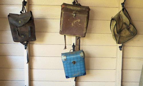 Bags hanging on the schoolroom wall. I had a well-used version of the blue one. but I think it was a different colour.