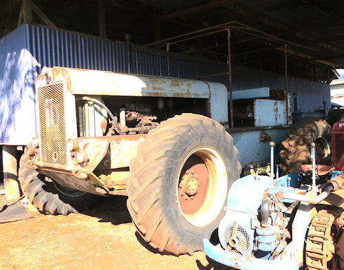 This big blue machine came from a farm near my old home. A friend's father modifies it to keep it working. My older brother even remembers driving it one - about forty years ago.